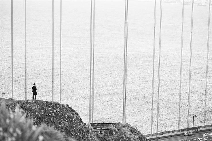 Man Standing Near the Golden Gate Bridge ➤ DOWNLOAD by click on the picture ➤ #Bridge #Minimalistic #Blackandwhite #GoldenGateBridge  #Gray #Man
