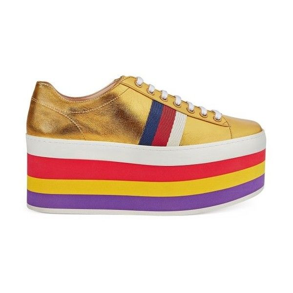 Women's Gucci Peggy Flatform Sneaker ($890) ❤ liked on Polyvore featuring shoes, sneakers, metallic gold, rainbow platform shoes, rainbow sneakers, platform shoes, black and white stripe shoes and metallic gold sneakers