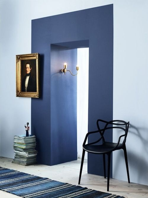 I like the idea of the dramatic doorway to a room. Maybe the small wall that the bedroom door is on should be a bold color.