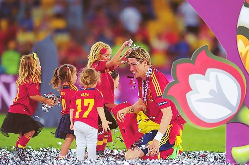 this is actually the cutest. Torres playing in the confetti with all the little Spanish children.