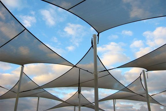 Coolaroo: Not Your Grandparent's Patio Umbrella. Shows multiple anchor points on one pole