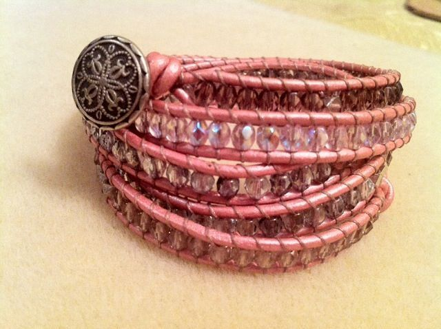 Pink shiny leather strap with dark purple, light pink, grey and clear Czech Crystal beads accented with silver plated beads.