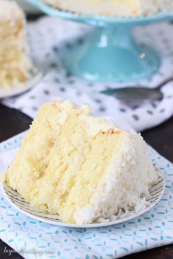Baked from scratch, this Coconut Custard Cake is layers of coconut cake, with a coconut custard filling and finished with a cream cheese icing.