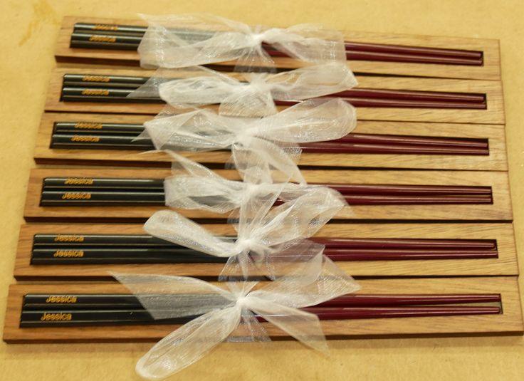 Set of custom engraved chopsticks made to order. Individual wooden gift packs