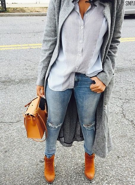 Love this casual look with ripped skinny jeans, camel ankle boots, a striped button-down shirt and a long coat! Perfect outfit for a casual Fall day.