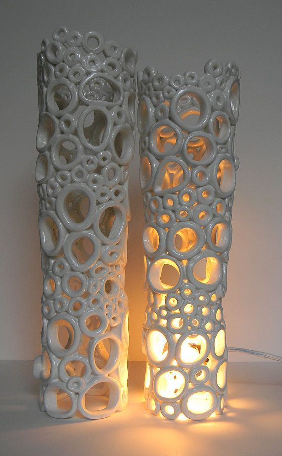 i like this ceramcs piece because you can imagine how hard it was to create it with all of the circles.  I wonder if she let the bottom circles harden so that the top ones wouldnt flatten the structure