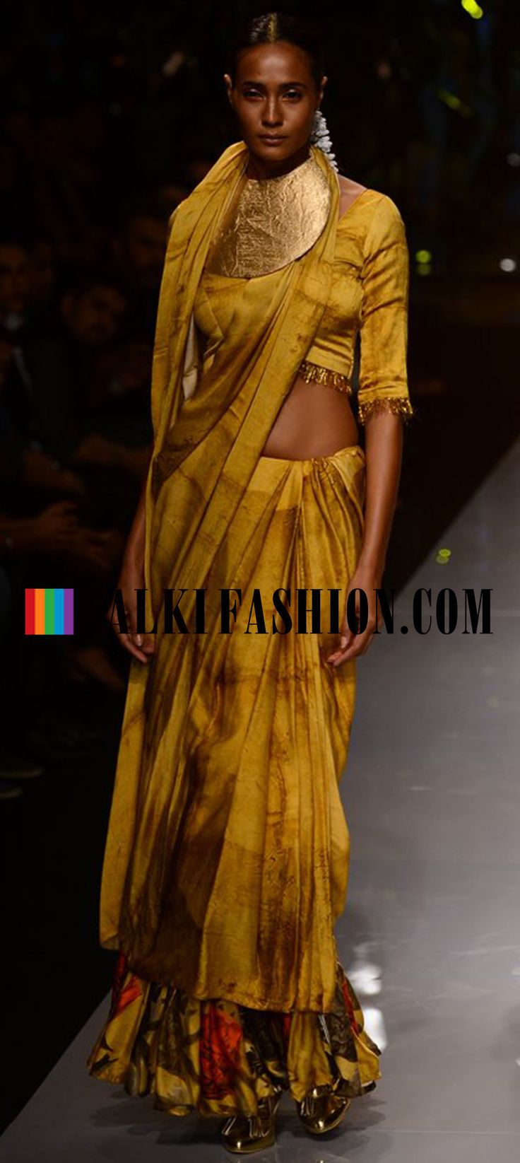 http://www.kalkifashion.com/designers/masaba.htmlModels walk the ramp in masaba outfit at Wills Lifestyle Indian Fashion Week 2014