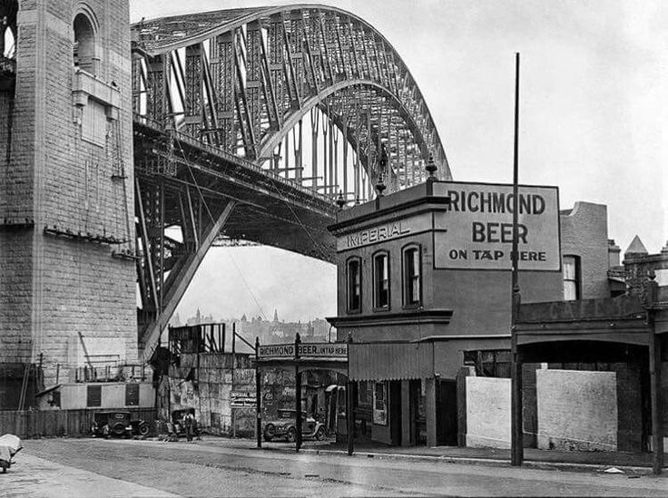 The Imperial Hotel and the nearly completed Sydney Harbour Bridge taken from the North side of the Harbour in early 1932. •Fairfax Archives•