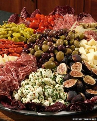 """Antipasto Platter - Antipasto means """"before the meal,"""" and this antipasto recipe doesn't disappoint. Serve up this antipasto of cured meats, fresh cheeses, and herbs that will satisfy guests until the next course is ready."""