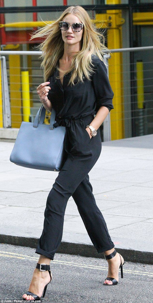 Rosie Huntington-Whiteley wears a stylish blue jumpsuit for a visit to M in London this week