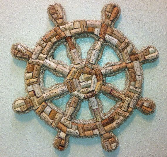 Handcrafted ships wheel made with real wine corks. This unique item measures 21 inches across and comes ready to hang on your wall.