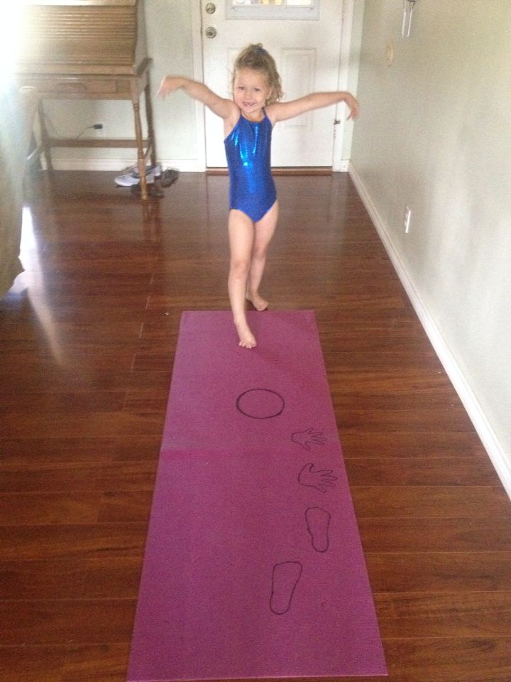 "Toddler Gymnastics: ""Cartwheel Exercises""took an old yoga mat, and made a guide for my 3yr. Old hand and feet placement."