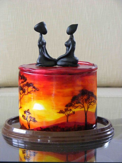 Wow... stunning. Have you noticed that I'm obsessed with hand-painted cakes? :) From the West Sussex Cupcake Company.