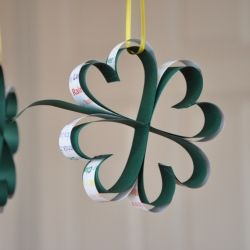 Make a paper four leaf clover.