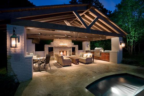 A beautiful outdoor kitchen space and fireplace accented with natural stone that has everything you need to cook or entertain in the outdoors.  Found on minimalisti.com