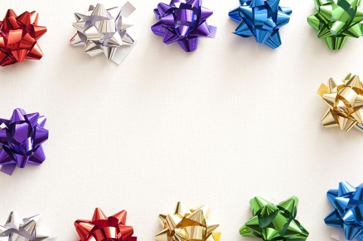 Border of colorful shiny metallic ribbon bows for packaging gifts around a central white copy space for a festive celebration - free stock photo from www.freeimages.co.uk