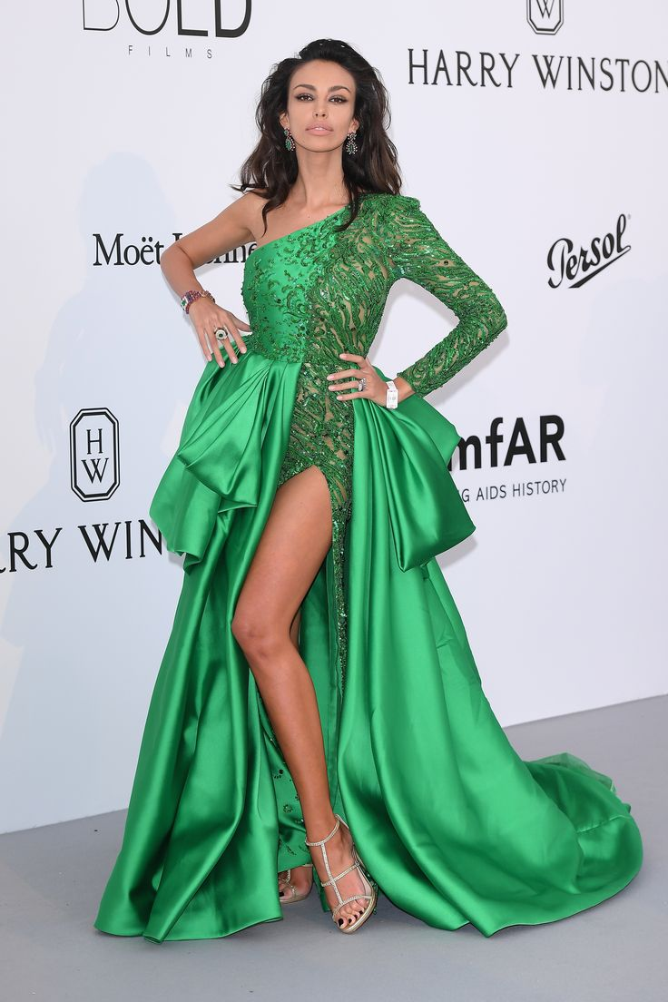 Madalina Ghenea wore vintage 1966 Bulgari emerald, diamond and ruby earrings in platinum and yellow gold, with a high jewellery ring in pink gold with chalcedony and agate inserts and a cabochon emerald and pavé diamonds. She also wore a vintage bracelet in gold with emeralds, amethysts, rubies, cultured pearls and diamonds (1988). To accessorise her green satin dress with bright green lace insert and thigh high split. At the amFAR Gala. For glamour celebrity fashion Cannes Film...