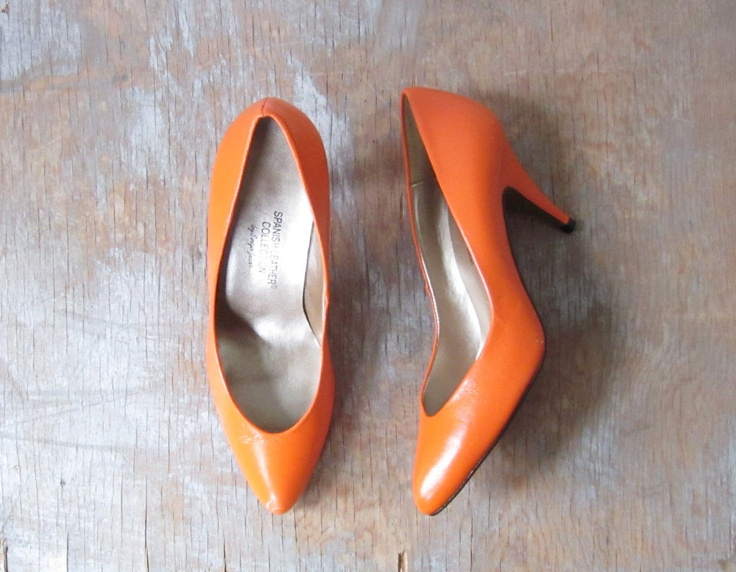 80s orange high heels / vintage 1980s orange pumps / vintage pumpkin orange leather shoes / size 5.5. $28.00, via Etsy.