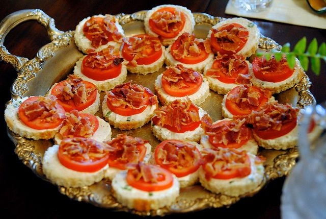 Mini, Open-face BLTs. Mix mayo (Duke's) and softened cream cheese with salt, pepper, and diced green onions. Spread it on bread and top with a roma tomato slice and crumbled bacon.