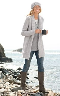 Place a long, loose, open sweater over a monochrome outfit. Pair with boots and a beanie for a casual, comfortable look.