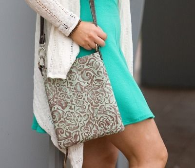 Is it a cross-body? Is it a shoulder bag? It's both!! Convertible, concealed-carry purse in several colors!