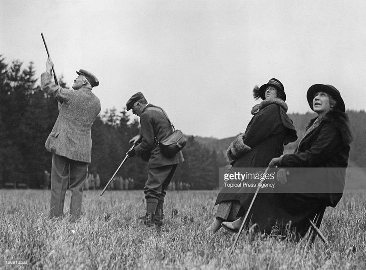 The Duke of Roxburgh, Henry Innes-Ker, 8th Duke of Roxburghe (1876 - 1932, far left) taking part in a pheasant shoot at a house party at the home of the Dowager Lady Nunburnholme at Warter Priory, East Yorkshire, 6th December 1922. Looking on are Mary Goelet, Duchess of Roxburghe (1878 - 1937) and Edith Vane-Tempest-Stewart, Marchioness of Londonderry (1878 - 1959).