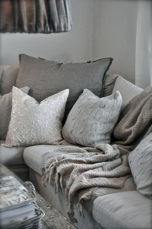 This mix of textures and shades of grey create a lovely cosy space.