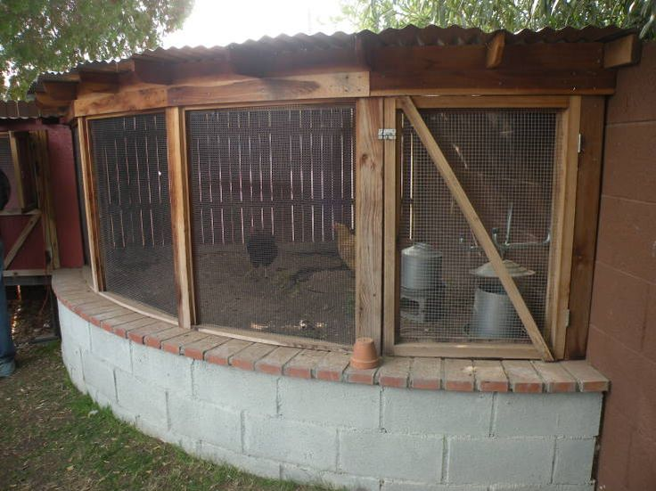 Creative way to protect the bottom of the chicken run and a good way to use the corner of the yard.