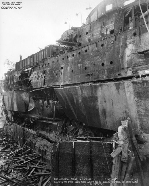 USS Oklahoma (BB 37), showing extent of torpedo damage, after being righted.  Evidence suggests possible mini submarine strike using larger Type 97 torpedoes (800lb TNT equiv. warhead), compared to the Type 91 aerial variety (450lb).