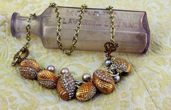 Wear it as a necklace or as a Bracelet, made with vintage worn brass and rhinestone buttons.