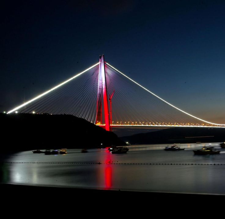 ISTANBUL, TURKEY - AUGUST 29 : Newly constructed Yavuz Sultan Selim Bridge is seen illuminated in Boshporus, Istanbul, Turkey on August 29, 2016. Third bridge linking the European and Asian sides of Istanbul, the Yavuz Sultan Selim Bridge --which is located in Bosphorus and named after early 16th century Ottoman Sultan Selim I, whose rule marked the expansion of the burgeoning world power in the Middle East -- is projected to be the widest bridge in the world, measuring 60 meters in width…
