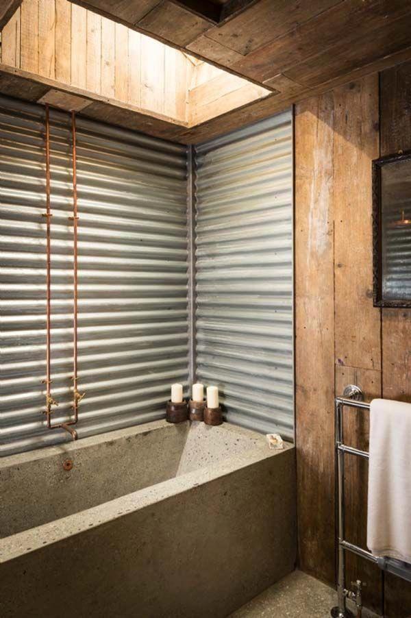 The Bathroom Features Corrugated Tin Walls And A Custom Built Concrete Bath And Countertop Th Rustic Bathroom Designs Modern Bathroom Remodel Rustic Bathrooms