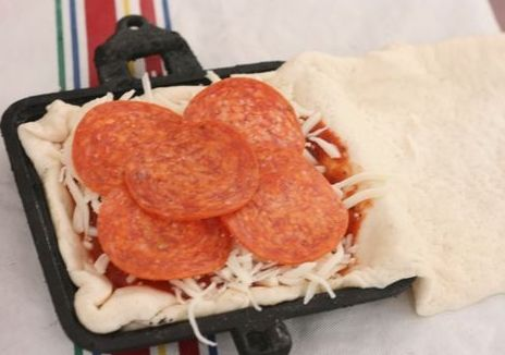 Campfire pizza calzones outdoor education pinterest for Pie iron recipes with crescent rolls
