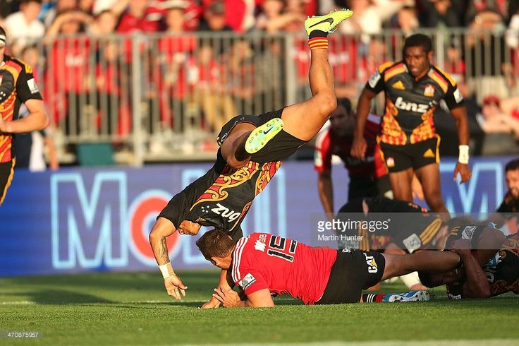 Israel Dagg of the Crusaders is tackled by Augustine Pulu of the Chiefs during the round two Super Rugby match between the Crusaders and the Chiefs at AMI Stadium on February 21, 2014 in Christchurch, New Zealand.