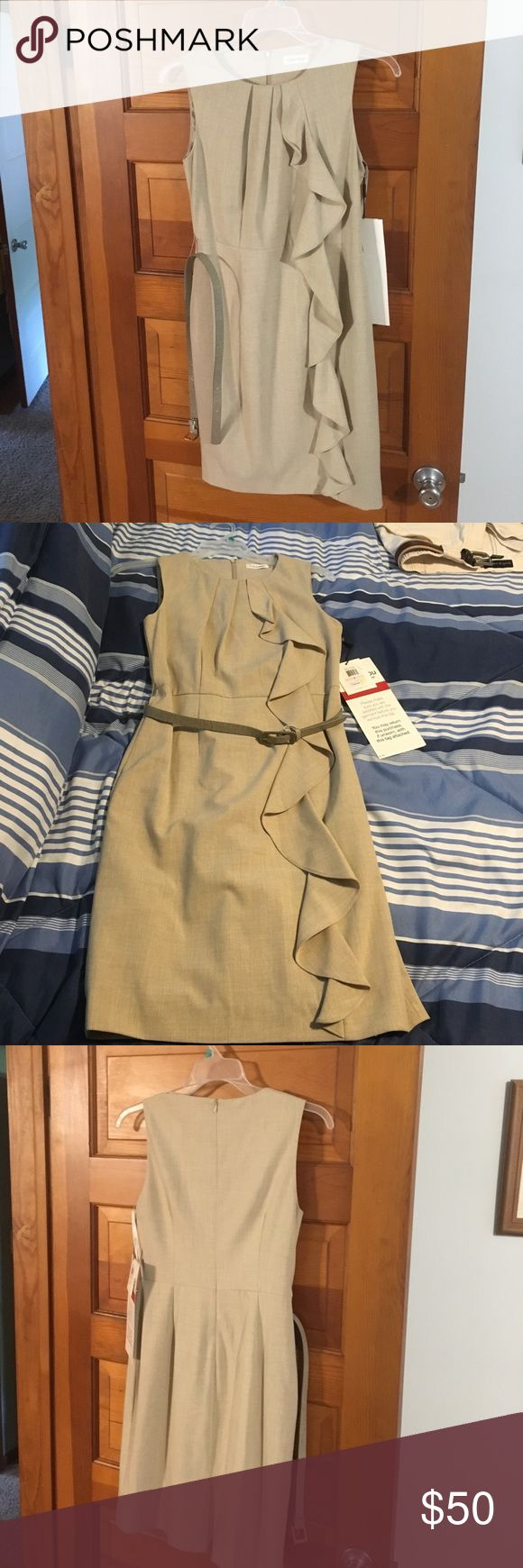New Calvin Klein Sandy dress This dress is brand new suggested retail price 128. Size 6 called sand. Beautiful ruffle up the left-hand side comes with the leather belt . Has a zipper in the back & slit at hem. It is lined @& in perfect condition😇 Calvin Klein Dresses Midi