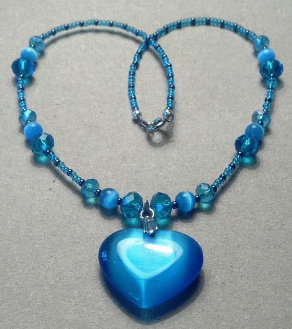 15 inch handmade blue crystals and cats eye by MGBeadCreations, $25.00