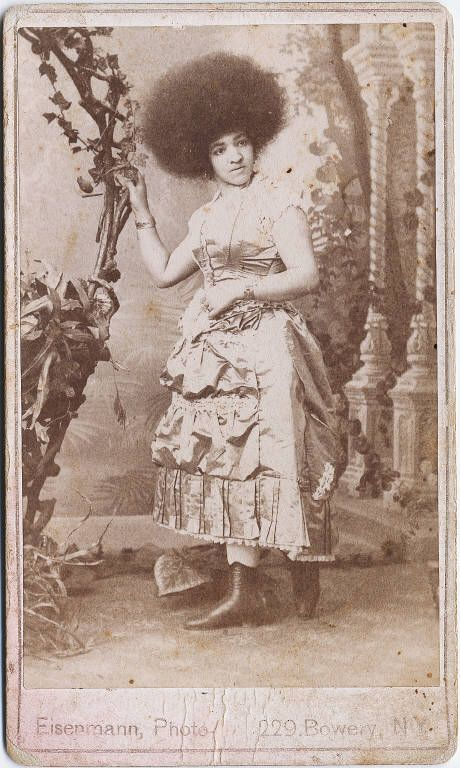 """This full length portrait of """"Zumigo; lady in very fancy dress and huge Afro, standing next to gigantic basket prop,"""" was taken in 1880.: 1880, African American, Fancy Dress, Vintage Photos, Afro, Natural Hair, Black History, Letter Of"""