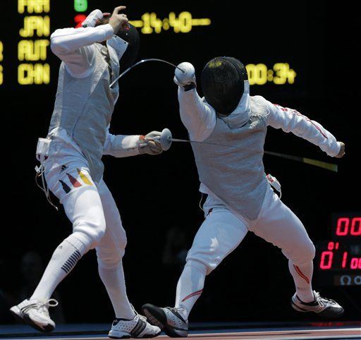 Benjamin Kleinbrink of Germany, left, and Yuki Ota of Japan compete during men's individual foil fencing at the 2012 Summer Olympics, Tuesday, July 31, 2012, in London. (AP Photo/Dmitry Lovetsky)