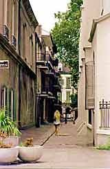 """Pirate Alley: subject of much legend and lore, some true, and much false. It is one of the """"must see"""" locations of the French Quarter.The alley is one block long, and extends from Chartres St. at Jackson Square to Royal St. Halfway down the alley, a lamppost marks its intersection by Cabildo Alley, which extends to St. Peter St."""