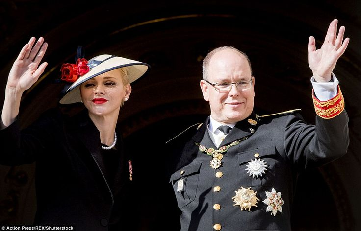 Waving to the crowds outside the Cathedral of Monaco Princess Charlene and Prince Albert i...