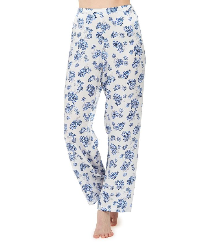 Ditsy Lotus Silk Pyjama Trousers £260 - White, Blue Floral Silk Pyjama Trousers – because pyjamas are a luxury we can't live without. Beautifully smooth for sleeping, pure indulgence for luxury lounging and effortlessly chic for mixing with day or evening wear. Our luxuriously supple, full-length trousers skim and flatter and sit just below the waist but are not low cut. A smooth, flat fronted waistband, and softly elasticated back ensures a super flattering fit.
