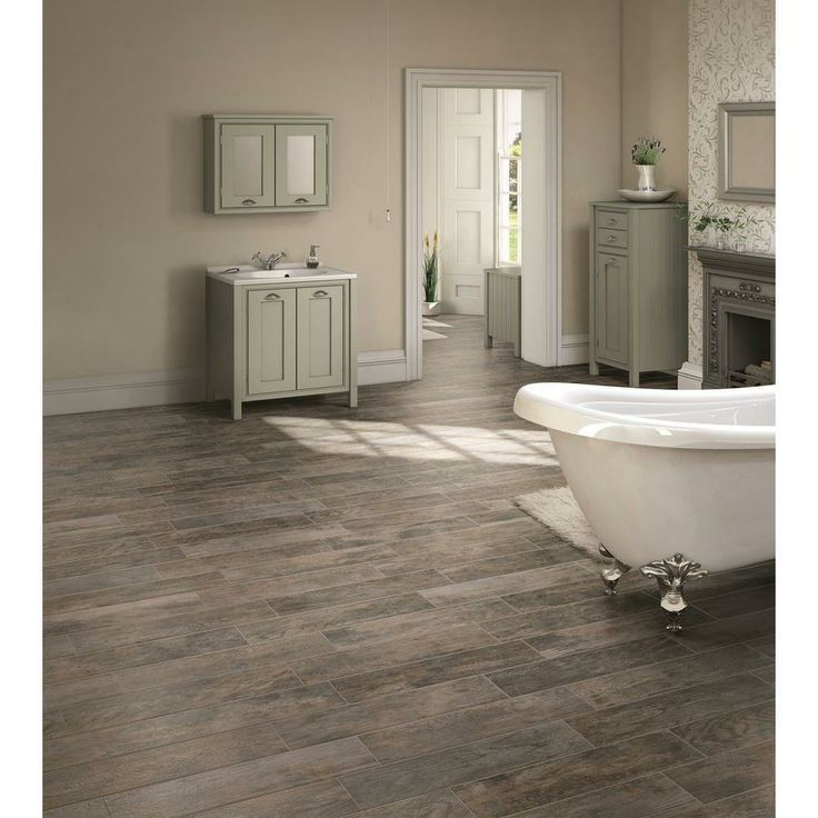 Marazzi tile floor....looks like rustic wood floors.  Costs less than wood flooring.