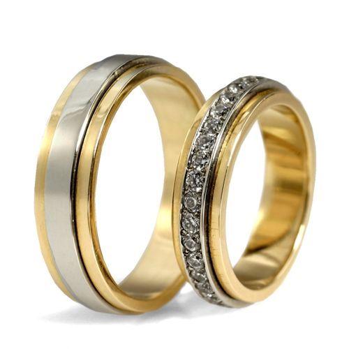 Obrączki ślubne z białego i żółtego złota z brylantmi o łącznej masie  0,63ct, obrotowe. Próba 0,585