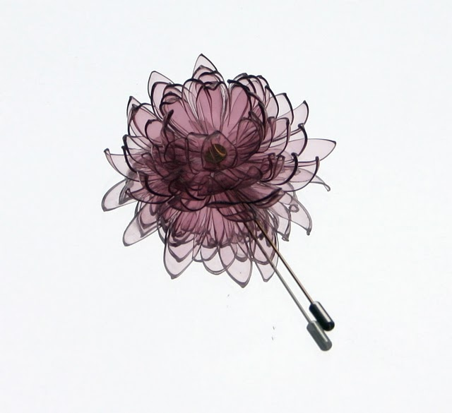 This exquisite brooch by GULNUR OZDAGLAR-TURQUEY, is made from discarded PET plastic water bottles.