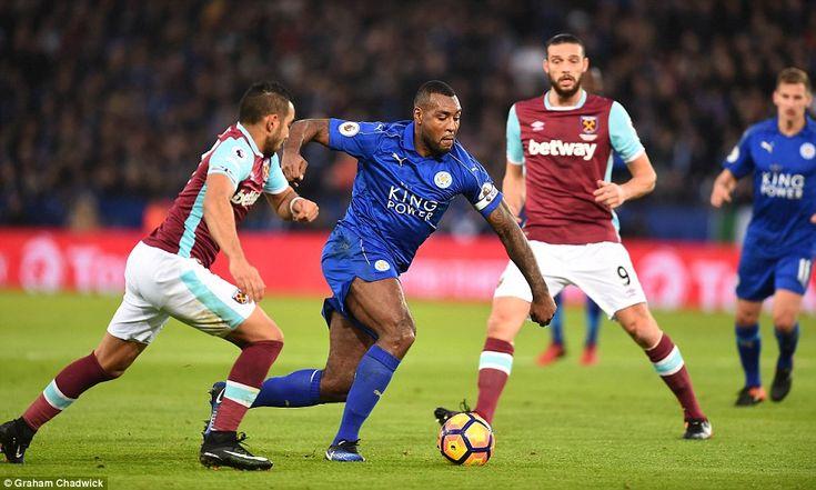 English forward Andy Carroll (No 9) watches on as Leicester skipper Morgan drives forward for Claudio Ranieri's men