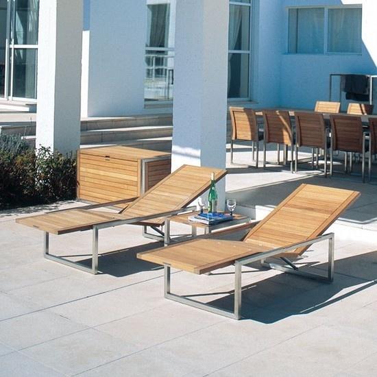 Contemporary Teak Outdoor Chaise Lounge  Contemporary outdoor chaise lounge has a slatted teak and aluminum frame.