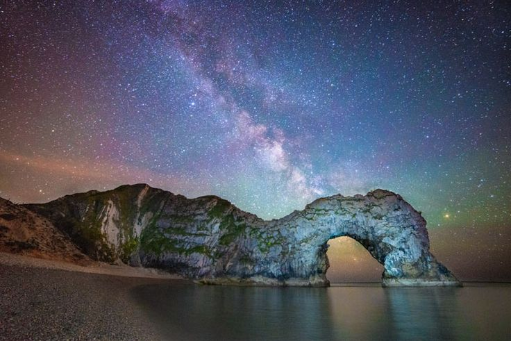 The Milky Way seen behind the natural archway of Durdle Door in a shot on the shortlist for the Roya