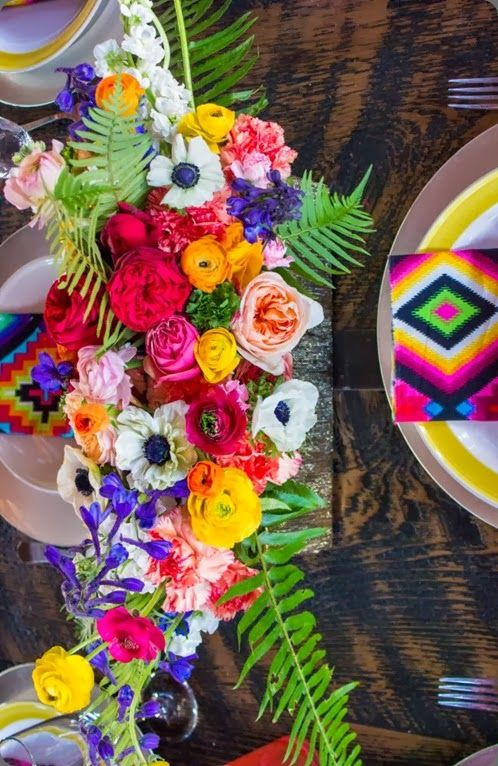 Fiesta-themed table setting and flowers.