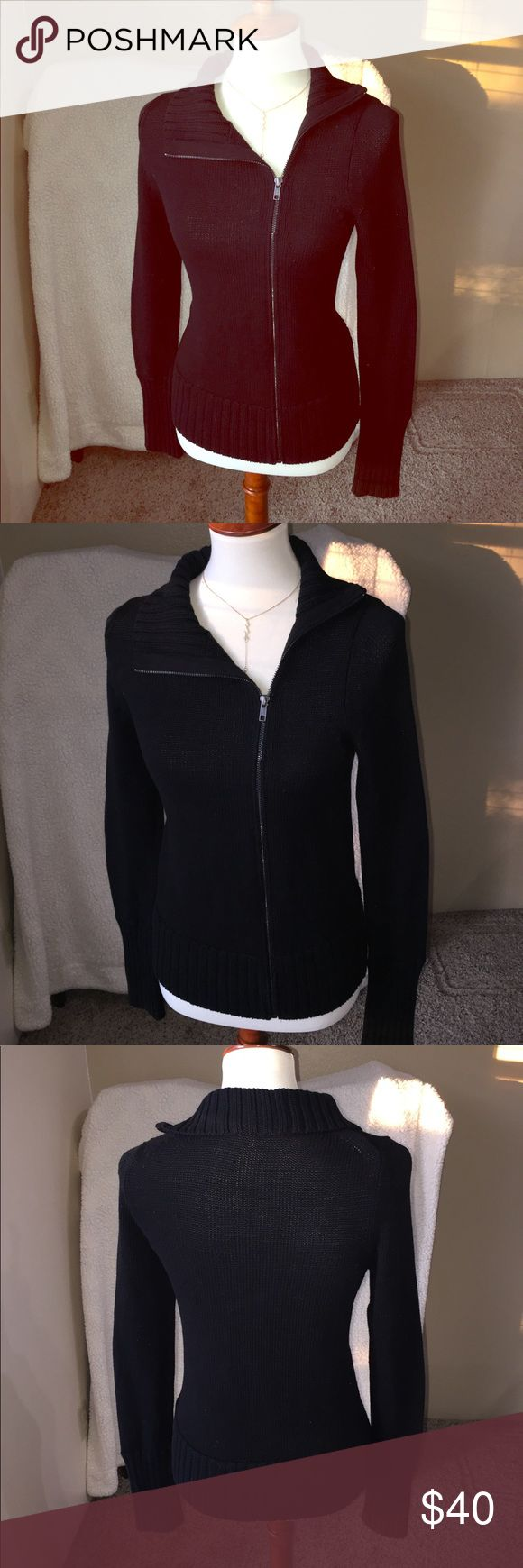 VS black moto sweater Victoria's Secret moto sweater has an angled zipper like you would expect in any moto jacket. Comfortable knit sweater material, this piece has a flattering fit, feminine outline, and long sleeves. Item never actually worn, but their items do not come with tags. Open to offers and questions. Victoria's Secret Sweaters