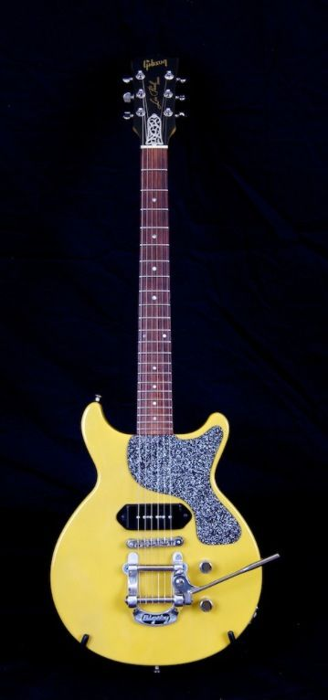 Awesome Gibson Guitar: TV Yellow Double Cutaway Les Paul with static patterned scratchplate